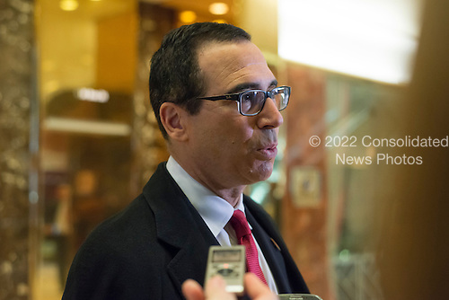 Steven Mnuchin, a contender for the position of Secretary of the U.S. Treasury under the Trump administration, arrives at Trump Tower, in New York, NY, USA on November 30, 2016. <br /> Credit: Albin Lohr-Jones / Pool via CNP