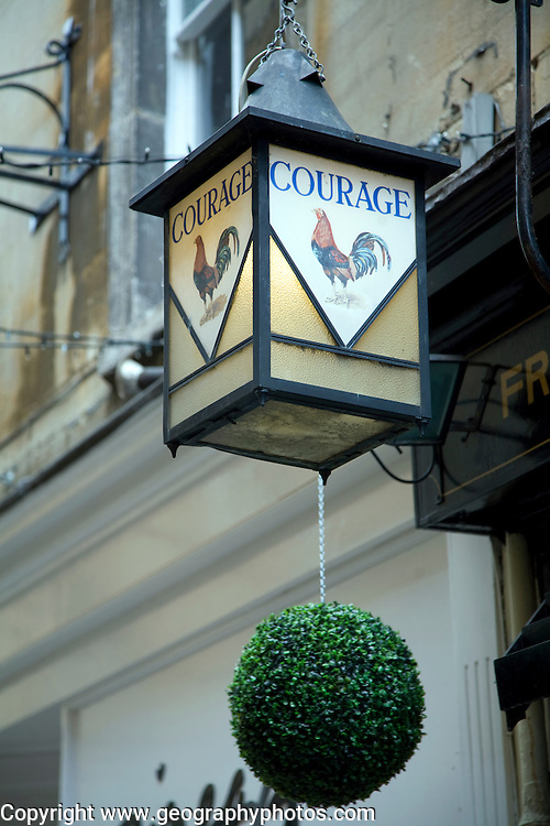 Old glass lamp sign for Courage beer, Bath, England
