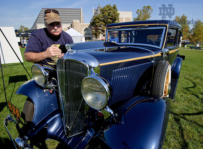 Oct. 8, 2011; Owner George Gajdos of Orange County California polishes his 1931 Rockne model car for display at the Irish Green before the Air Force game. The Rockne was a subsidiary of the Studebaker Corporation named after football coach Knute Rockne...Photo by Matt Cashore/University of Notre Dame