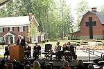 Thursday, May 31, Charlotte, North Carolina. Dedication ceremony for the new Billy Graham Library in Charlotte, North Carolina.. The reverend  Billy Graham at the podium..Behind him (l to r)  Cliff Barrows, Franklin Graham George HW Bush, Jimmy Carter and Bill Clinton.