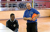 Premises staff manager talking with a Work Experience student, State Secondary Roman Catholic school.