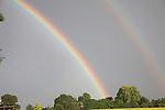 Double rainbow in grey stormy sky, Butley, Suffolk, England, UK