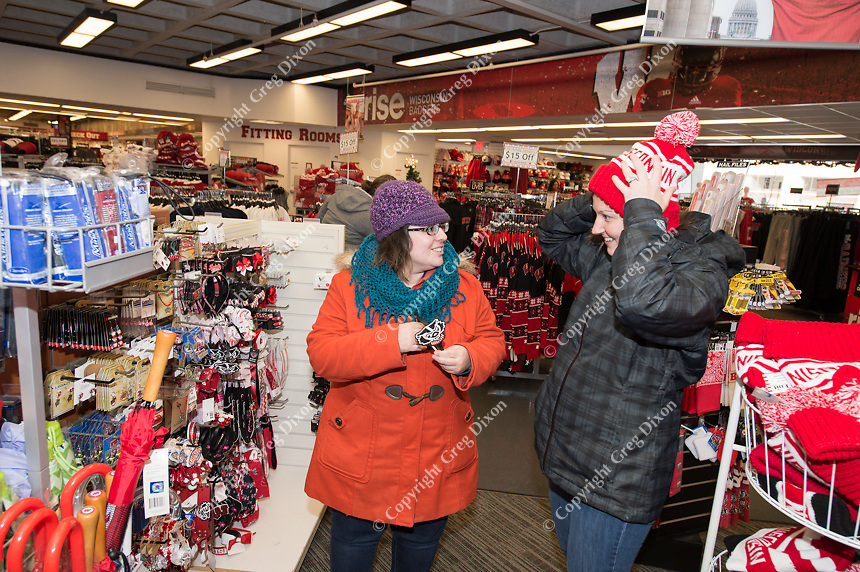 People shop at The University Book Store on State Street and the University of Wisconsin Library Mall on Friday, December 18, 2015 in Madison, Wisconsin