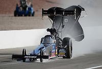 Mar. 31, 2012; Las Vegas, NV, USA: NHRA top fuel dragster driver David Grubnic during qualifying for the Summitracing.com Nationals at The Strip in Las Vegas. Mandatory Credit: Mark J. Rebilas-