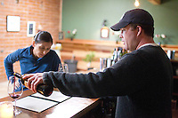 1/2/2011-  Todd Bostock pours a glass of wine for Lesley Trujillo in the tasting room at Dos Cabezas Wineworks, in Sonoita, Arizona. (Photo by Pat Shannahan)