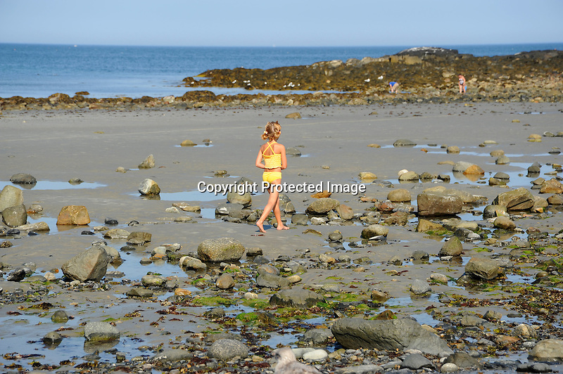 Young Girl Beachcombing in Maine, USA