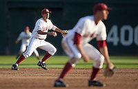 STANFORD, CA - April 12, 2011: Kenny Diekroeger of Stanford baseball reacts to the ball coming off the bat during Stanford's game against Pacific at Sunken Diamond. Diekroeger fielded the grounder for the out at first. Stanford won 3-1.