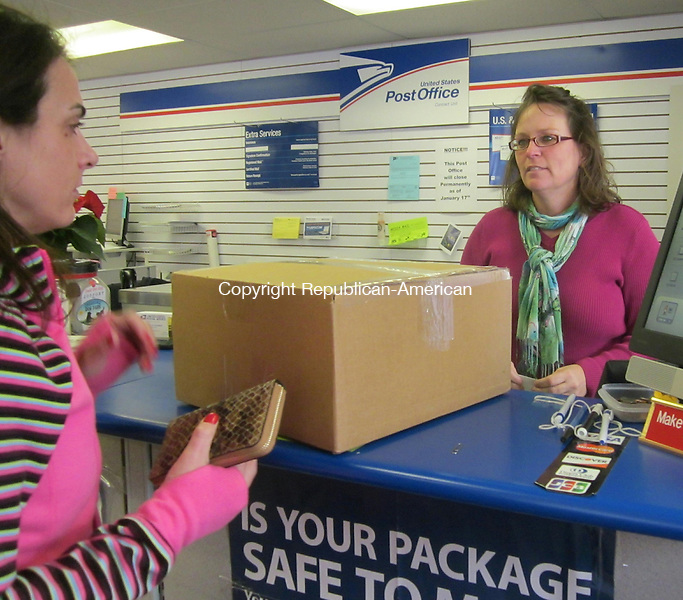 CHESHIRE, CT -  Dec. 11, 2013 - 121113LX04 - Customers of a  U.S. Postal Service commercial contract unit at the Timerline Business Center are being told of its closure this week. Manager Joann M. Monroe helps a customer on Wednesday.