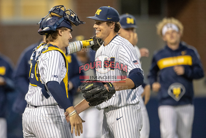 Michigan Wolverines catcher Casey Buckley (24) celebrates with pitcher Keaton Carratini (28) after the NCAA baseball game against the Eastern Michigan Eagles on May 8, 2019 at Ray Fisher Stadium in Ann Arbor, Michigan. Michigan defeated Eastern Michigan 10-1. (Andrew Woolley/Four Seam Images)
