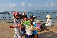 Local children selling sea-shells. Mui Ne, Vietnam