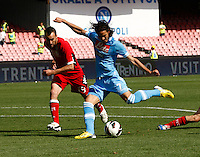 Napoli's  forwrd Edinson Cavani shoots  during their Italian Serie A soccer match against Siena  at the San Paolo stadium in Naples.