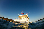 Motor Yacht Outer Reef 63.The Taiwanese-built Outer Reef 63.Outer Reef constructed the 63--currently the smallest in a fleet of motoryachts ranging to 115 feet--with a traditional hand-laid FRP hull that's solid fiberglass below the waterline and cored with PVC sandwich above. This combination helps provide strength while keeping displacement at a moderate 73,000 pounds.