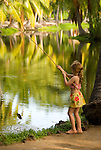 Young girl fishing in pond, Kona Village, Hawaii