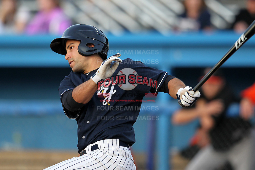 Empire State Yankees second baseman Kevin Russo #7 gets a hit during a game against the Norfolk Tides in the first ever Triple-A International League game at Dwyer Stadium on April 20, 2012 in Batavia, New York.  Empire State defeated Norfolk 6-4.  (Mike Janes/Four Seam Images)