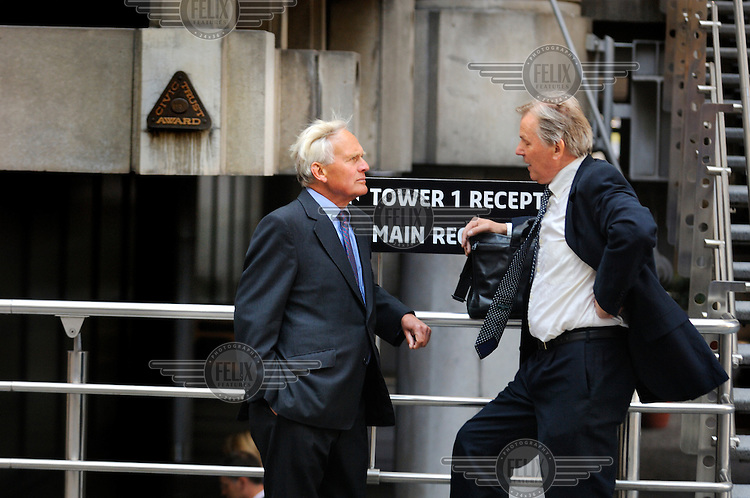 Businessmen in the City of London, outside Lloyds Tower.