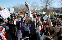 NWA Democrat-Gazette/DAVID GOTTSCHALK Julia Sasine, a senior at Bentonville High School and member of the Bentonville High School Students for Safer Schools, speaks Wednesday, March 14, 2018, following a 17 minute silent observance for the shooting victims  Marjory Stoneman Douglas High School in Parkland, Florida. About 400 students from the school participated in the silence and a series of chants and speeches as they lined S.E. J Street in Bentonville.