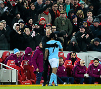 Manchester City's Raheem Sterling gets a hug from Josep Guardiola and boos from the home crowd on leaving the field<br /> <br /> Photographer Alex Dodd/CameraSport<br /> <br /> The Premier League - Liverpool v Manchester City - Sunday 14th January 2018 - Anfield - Liverpool<br /> <br /> World Copyright &copy; 2018 CameraSport. All rights reserved. 43 Linden Ave. Countesthorpe. Leicester. England. LE8 5PG - Tel: +44 (0) 116 277 4147 - admin@camerasport.com - www.camerasport.com