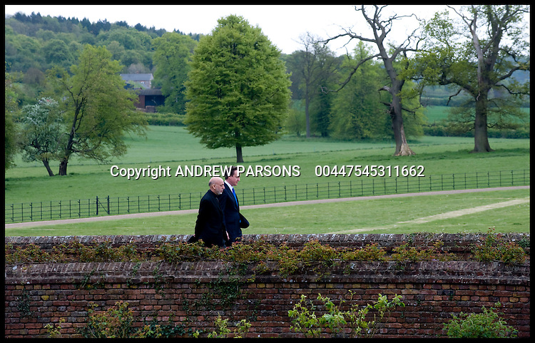 British Prime Minister David Cameron walks around the garden of Chequers with the Afghan President Hamid Karzai, Saturday May 15, 2010. Photo By Andrew Parsons