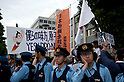 June 22, 2012, Tokyo, Japan - Group for power plants in Japan faces nuclear demonstrators during a demo to protest restarting Oi plant. Anti-nuclear protesters stage a Twitter organized rally in front of the Prime Minister's Official Residence opposing the reactivation of the Oi Nuclear Power Plant in Fukui Prefecture. ..