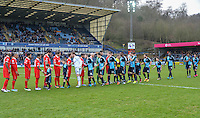 The teams shake hands during the Sky Bet League 2 match between Wycombe Wanderers and Leyton Orient at Adams Park, High Wycombe, England on 23 January 2016. Photo by Claudia Nako / PRiME Media Images.