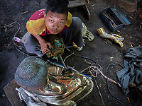 Metal workshop in Mandalay for buddha statues, Myanmar, Burma