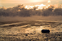 Ocean sea smoke at sunrise off Rye, New Hampshire. Photograph by Peter E. Randall.