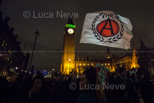 Parliament Square.<br /> <br /> London, 05/11/2015. Thousands of protesters gathered this evening in central London to take part in a demonstration called the &quot;Million Mask March&quot;, which is organised annually by Anonymous, and held globally in more than 400 cities planned to coincide with Guy Fawkes Night (The Gunpowder Plot of 1605). The aim of the demo was to highlight social injustice and Government corruption across the globe, but also to protect the environment, freedom of the internet, oppose mass surveillance and austerity. The rally started in Trafalgar Square, and then the protesters marched on Whitehall, gathering in Parliament Square. Around 7:00pm, a large group marched towards Great George street where clashes erupted with police officers in full riot gears, supported by police dogs and mounted police. Then, the demonstration carried on towards Victoria (where a police car was set on fire), Buckingham Palace and The Mall, to end in the Trafalgar Square area, where the police contained the last activists in &quot;kettles&quot; until around 11:30pm.<br /> <br /> For more information please click here: http://on.fb.me/1mcn5Z7