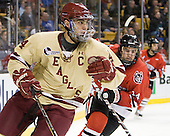 Tommy Cross (BC - 4), Braden Pimm (Northeastern - 14) - The Boston College Eagles defeated the Northeastern University Huskies 7-1 in the opening round of the 2012 Beanpot on Monday, February 6, 2012, at TD Garden in Boston, Massachusetts.