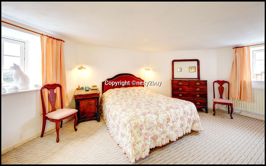 BNPS.co.uk (01202 558833)<br /> Pic: next2buy/BNPS<br /> <br /> ***Please use full byline*** <br /> <br /> Bedroom.<br /> <br /> An Englishman's home is his castle...<br /> <br /> An incredible property that looks like a miniature castle has come on the market for the bargain price of £250,000.<br /> <br /> The Grade II listed building was erected in 1720 and features an amazing turret that boasts countryside and harbour views.<br /> <br /> It was originally used as a watch tower and the rest of the building was used as an office by the harbour master.<br /> <br /> The building, which is in Whitley Bay, Tyne and Wear, boasts four bedrooms, an open plan kitchen and dining room, and a spacious living room.<br /> <br /> It also has a yard at the back and is just a stone's throw away from the stunning coastal walk surrounding Colywell Bay.<br /> <br /> The property is being sold through Next2Buy estate agents who are based in Tyneside.