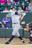 Bubba Starling (16) of the Wilmington Blue Rocks follows through on his swing against the Winston-Salem Dash at BB&T Ballpark on April 3, 2014 in Winston-Salem, North Carolina.  The Blue Rocks defeated the Dash 3-1.  (Brian Westerholt/Four Seam Images)