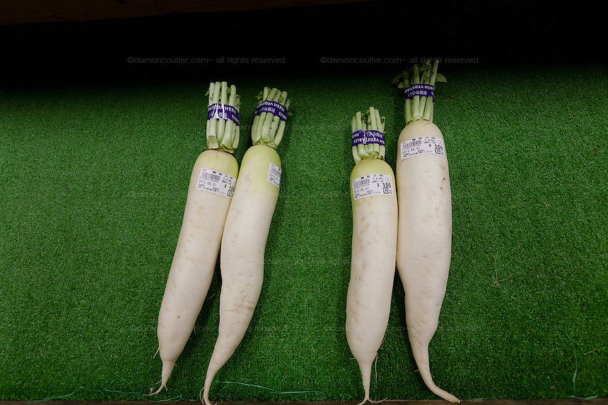 Daikon or Japanese white radishes on sale at a farmers market in Miharu, Fukushima, Japan, Wednesday May 1st 2013. The food is grown locally and tested for radioctive contamination before being sold cheaply in the store.