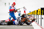 New Zealand competitor John Lilburne takes aim in the prone position at The International Biathlon Union Cup #6 Men's 10 KM Sprint.  The race was held at the Canmore Nordic Center in Canmore Alberta, Canada, on Feb 12, 2012. Patrick finished in 55th position.