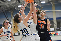 Har-Ber guard Caylan Koons (5) and forward Mary Blake Martfeld (20) rebound, Friday, February 7, 2020 during a basketball game at Wildcat Arena at Har-Ber High School in Springdale. Check out nwaonline.com/prepbball/ for today's photo gallery.<br /> (NWA Democrat-Gazette/Charlie Kaijo)