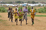 Girls hurry to school in the Dereig Camp for internally displaced persons.