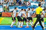 Ignacio Ortiz #16 of Argentina, Lucas Vila #12 of Argentina and Manuel Brunet #24 of Argentina celebrate their first goal during Argentina vs Belgium  in the men's gold medal game at the Rio 2016 Olympics at the Olympic Hockey Centre in Rio de Janeiro, Brazil.