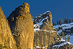 Golden Sunset light on overhang granite rock spire of Leaning Tower, Yosemite Valley, Yosemite National Park, California