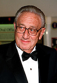 Former United States Secretary of State Henry A. Kissinger arrives at The White House in Washington, D.C. on October 29, 1997 for a State Dinner for President Jiang Zemin of China.<br /> Credit: Ron Sachs / CNP