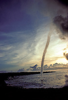 A water spout, a whirling tornado on the ocean, is  formed during a squall off the coast of the Big Island of Hawaii.