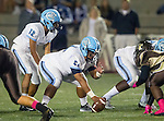 Torrance, CA 10/02/15 - Jaja Bellinger (Carson #12) and Raoul Lagpao (Carson #54) in action during the Carson-West Torrance CIF varsity football game at West Torrance High School.  Carson defeated West Torrance 34-27.