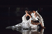 """Estela Merlos at front. Rambert Dance Company perform the new pice """"Labyrinth of Love"""" by choreographer Marguerite Donlon at Sadler's Wells Theatre, London. Music by Michael Daugherty, visual imagery by Mat Collishaw. With the soprano Kirsty Hopkins. Photo credit: Bettina Strenske"""