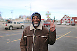 Kenneth Potter Sr. flashes the peace sign in the American Legion Post 6  parking lot near Lincolnway earleir this week. Potter who is homeless said good friends and family is what makes living in Laramie County special.  To take part in WTE Photo Editor Michael Smith's Our Faces: Portraits of Laramie County project, call 633-3124 or 630-8388 or email msmith@wyomingnews.com to make an appointment. To see all of the portraits published so far, go online to ourfaces.wyomingnews.com. Michael Smith/staff
