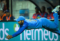 Dinesh Karthik catches Daryl Mitchell during the international Twenty20 cricket match between NZ Black Caps and India at Westpac Stadium in Wellington, New Zealand on Wednesday, 6 February 2019. Photo: Dave Lintott / lintottphoto.co.nz