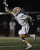 Louis Perfetto #8 of Manhasset reacts after scoring a goal in the third quarter of the 131st Woodstick Classic against Garden City at Manhasset High School on Saturday, April 29, 2017. Manhasset won by a score of 10-8.