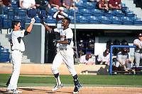 Manny Jefferson (5) of the Pepperdine Waves is greeted by teammate Matt Gelalich (13) after hitting a home run during a game against the Texas A&M Aggies at Eddy D. Field Stadium on February 26, 2016 in Malibu, California. Pepperdine defeated Texas A&M, 7-5. (Larry Goren/Four Seam Images)