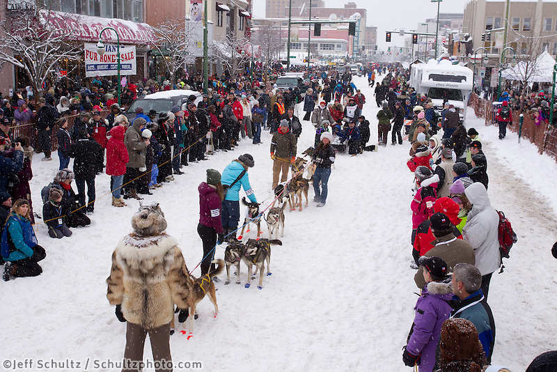 Saturday, March 3, 2012   Bill Pinkham's team is held by handlers as they get ready to go to the start line at the Ceremonial Start of Iditarod 2012 in Anchorage, Alaska.