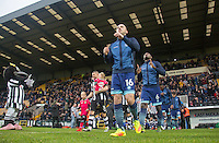 The teams head out during the Sky Bet League 2 match between Notts County and Wycombe Wanderers at Meadow Lane, Nottingham, England on 10 December 2016. Photo by Andy Rowland.
