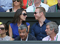 OIC - ENTSIMAGES.COM -  Sir Chris Hoy watches Andy Murray of Great Britain celebrates his win in the Gentlemen's Singles Final match against Novak Djokovic of Serbia of the Wimbledon Lawn Tennis Championships at the All England Lawn Tennis and Croquet Club 7th July 2013     Photo Ents Images/OIC 0203 174 1069