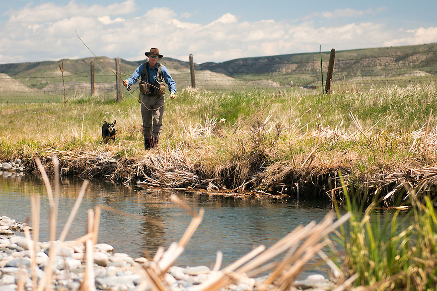 Ed Tompkins of Bozeman fishes a section of Darlington Spring Creek with his dog Chica.