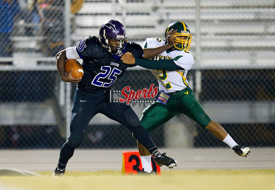 Jhaquille Hankerson (25) of the Cox Mill Chargers tries to stiff arm Jarod Garrick (2) of the Central Cabarrus Vikings at Cox Mill High School Stadium October 29, 2010, in Concord, North Carolina.  The Chargers defeated the Vikings 48-23.  (Brian Westerholt/Sports On Film)
