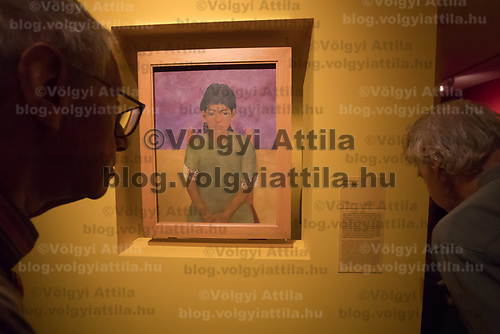 Visitors watch an artwork by Mexican painter Frida Kahlo titled Little Virginia seen on display at the Frida Kahlo exhibition in the National Gallery in Budapest, Hungary on July 5, 2018. ATTILA VOLGYI